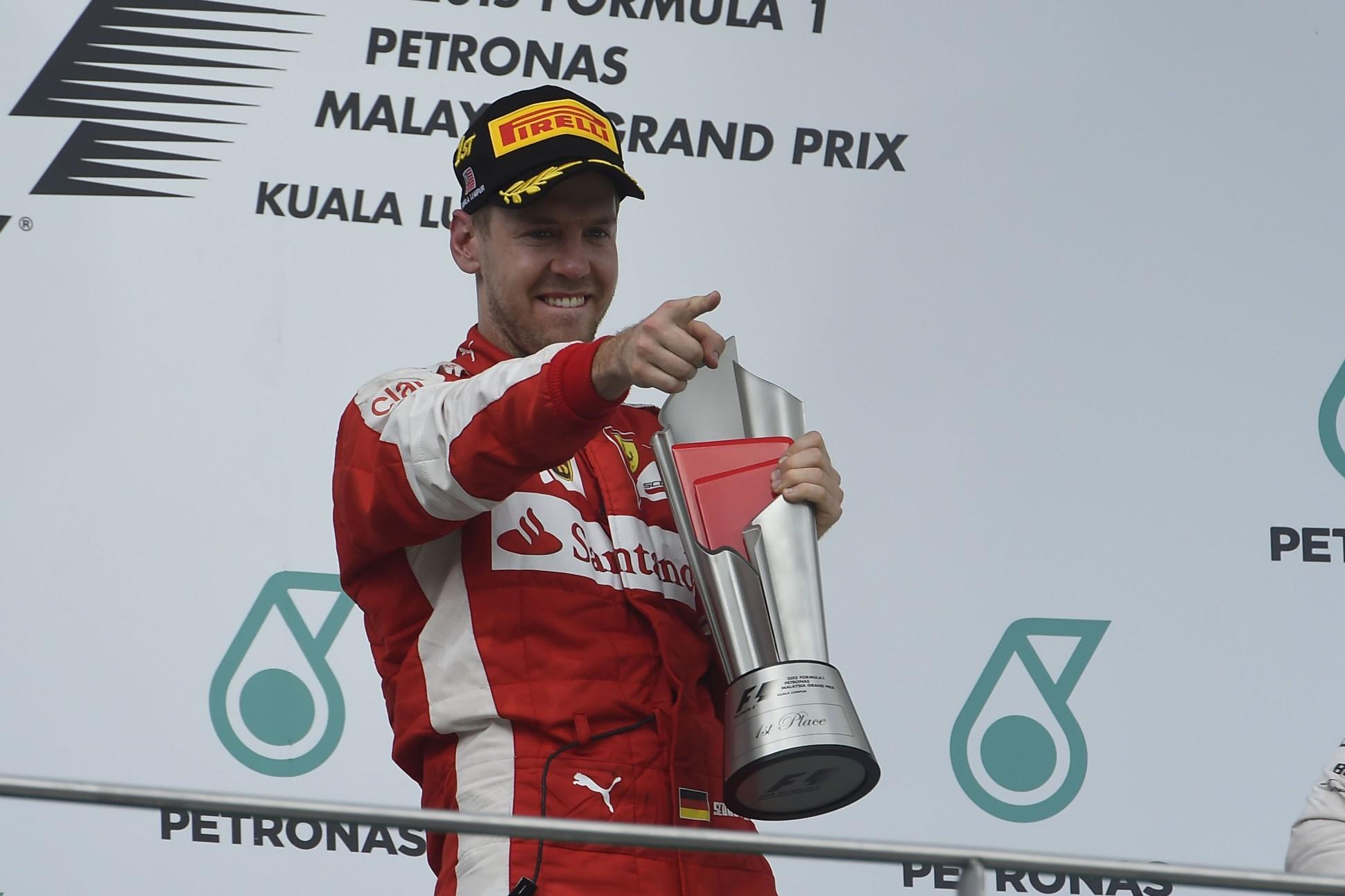 Vettel auf dem Siegerpodest in Malaysia. Copyright: Ferrari