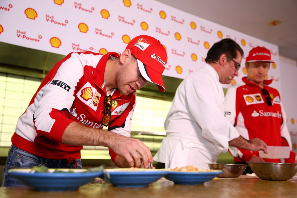 Sebastian Vettel and Kimi Raikkonen of Ferrari Meet Chef Guy Grossi