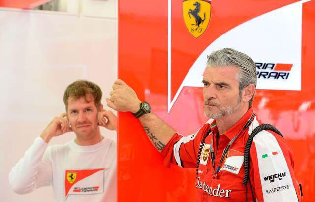 Ferrari-Teamchef Arrivabene und Vettel. Copyright: Ferrari