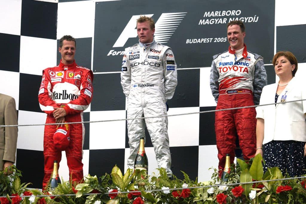 Ralf and Michael Schumacher on the podium in Budapest 2005. Credit: Ferrari