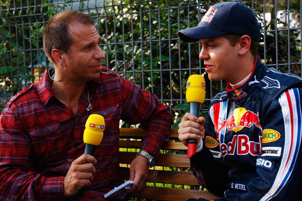 Formel 1 Kai Ebel mit Sebastian Vettel